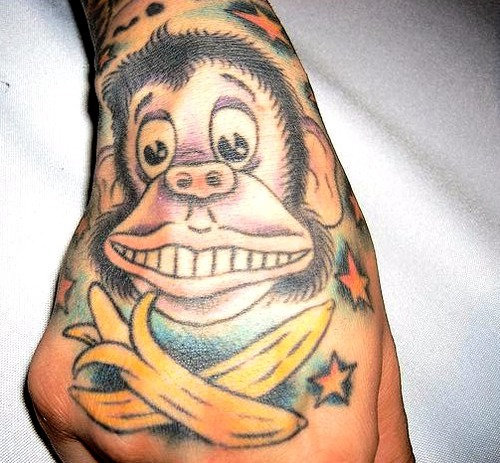 Tattoos de monos chistosos con bananas