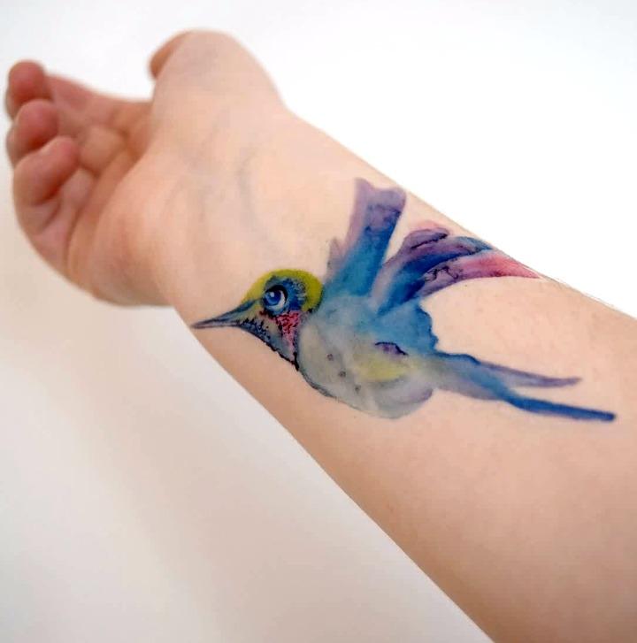 Tattoos de palomas al estilo acuarela
