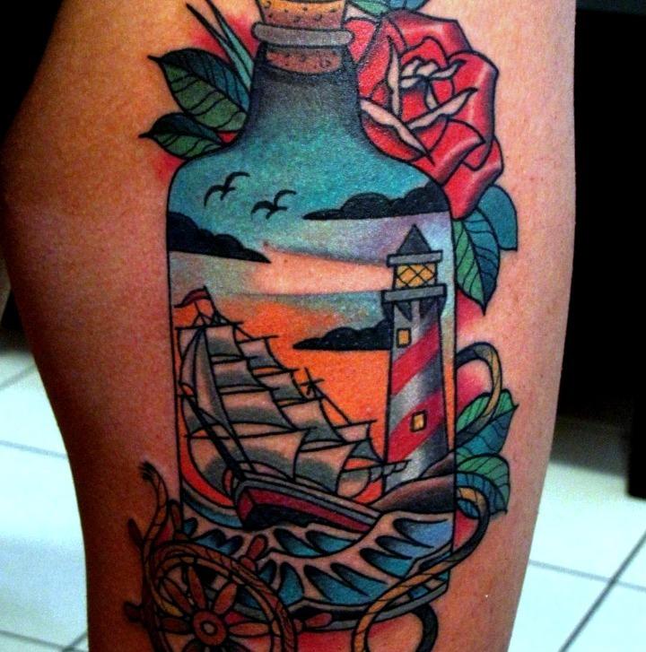 Tatuajes de carabelas dentro de una botella