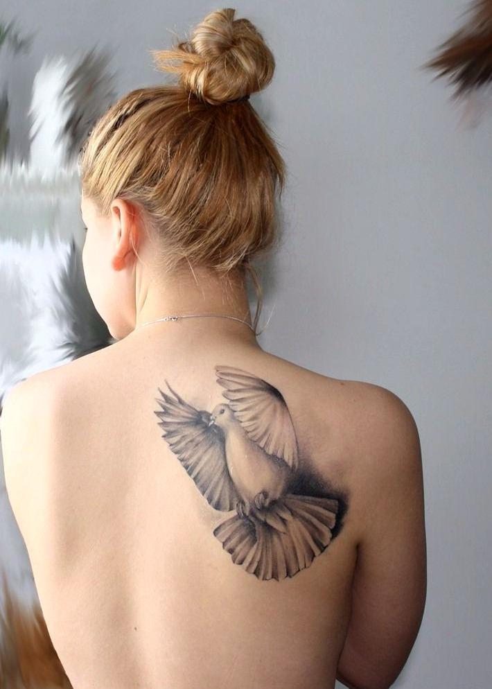Tatuajes de palomas volando