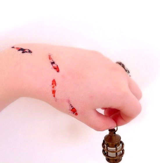 36 ideas de tatuajes de peces de hombre mujer fotos for Peces para acuarios pequenos
